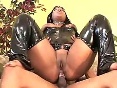 Nice black kitten pleasing herself